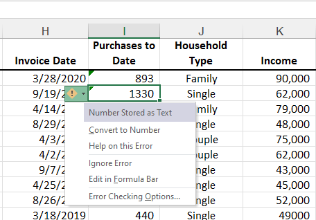 Green triangle in Excel
